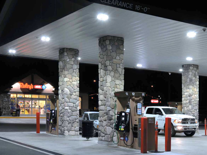 Gas station canopy with lighting underneath